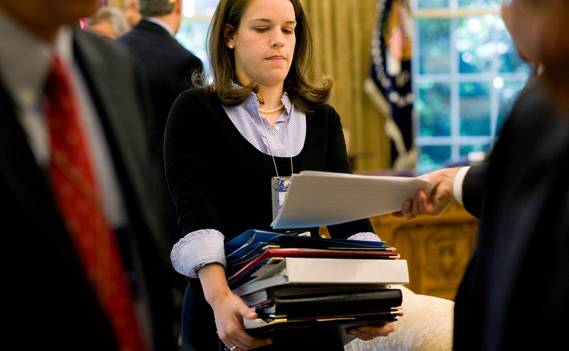 Normal_personal_secretary_carrying_a_stack_of_documents_o